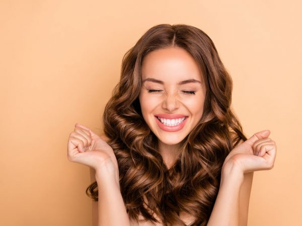 Close-up portrait of nice attractive lovely gorgeous girlish excited cheerful cheery, dreamy lucky wavy-haired girl enjoying expecting pleasure isolated on beige pastel color background